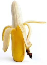partly peeled banana and banana skin