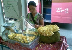 woman selling cut jackfruit