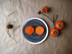 persimmon in plate
